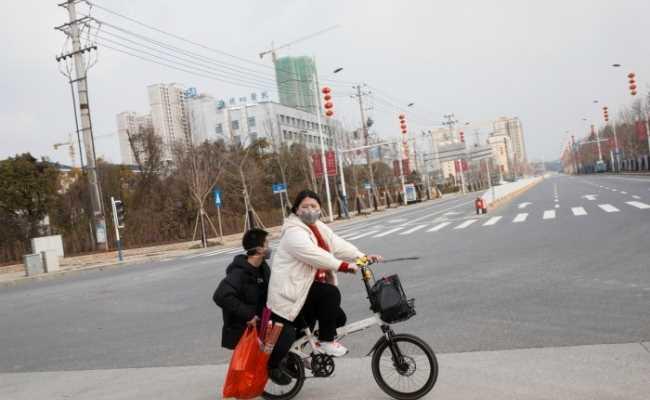В КНР 21 заражение коронавирусом за сутки